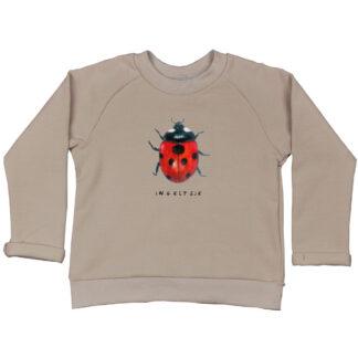 kindersweater met lieveheersbeestje. Gemaakt van GOTS gecertificeerd bio katoen.